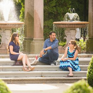 Students sitting on the steps of the fountains in Erlanger Gardens