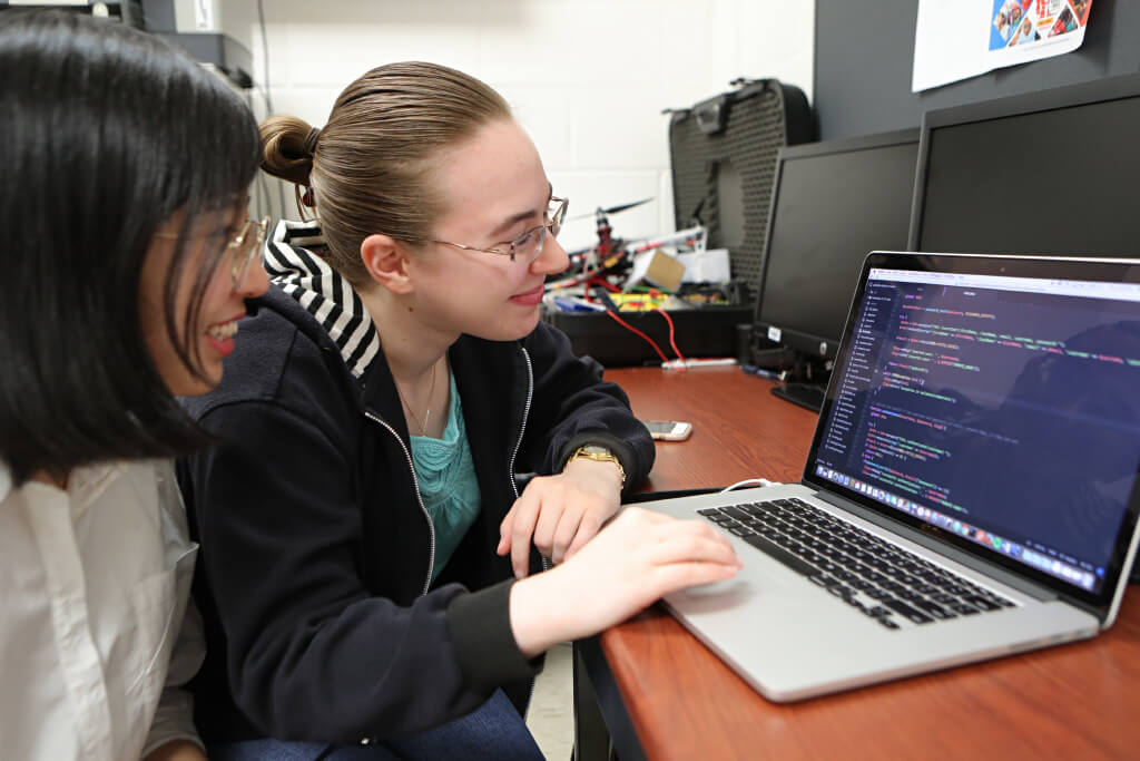 Computer Science students Shan Yi, left, and Mary Menges are pictured in the Computer Science Lab in Howard Hall