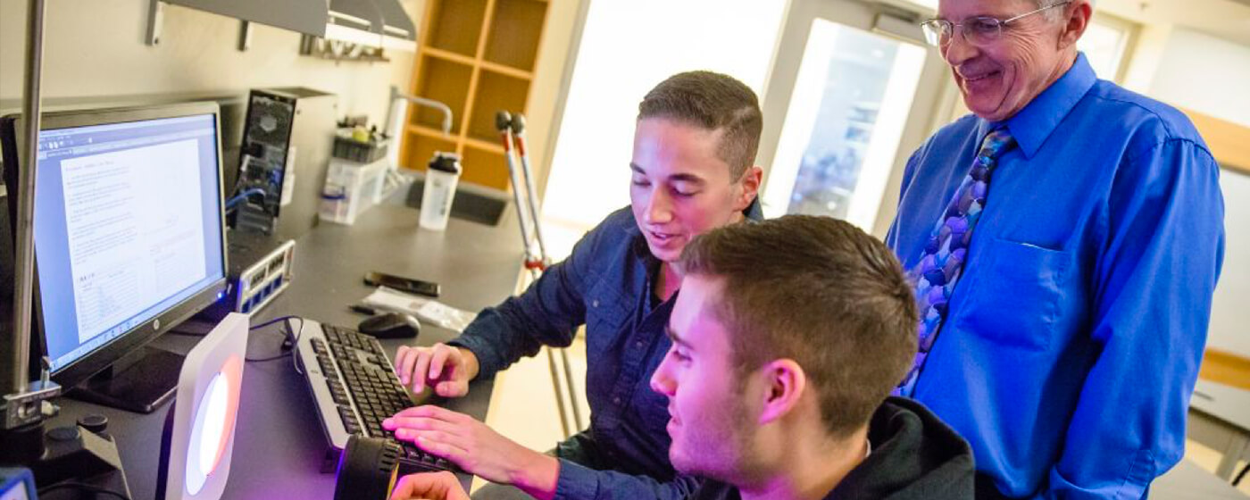 Students engaging in computer science studies