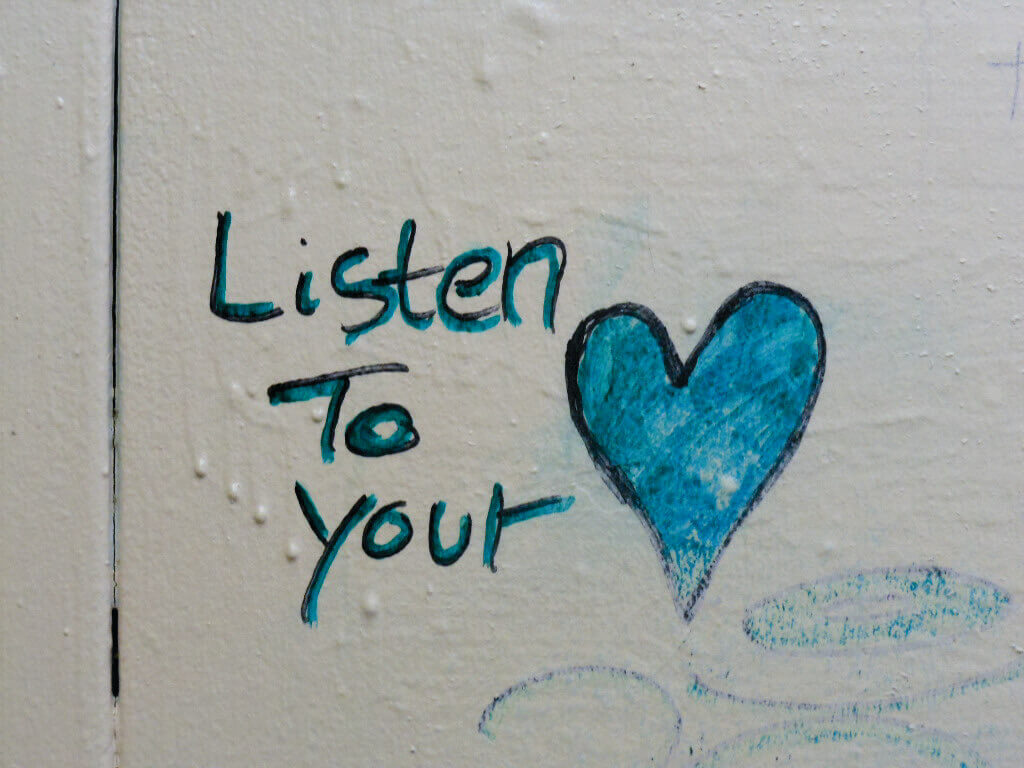A heart drawn onto a tile, with text next to it that reads 'Listen to Your.'