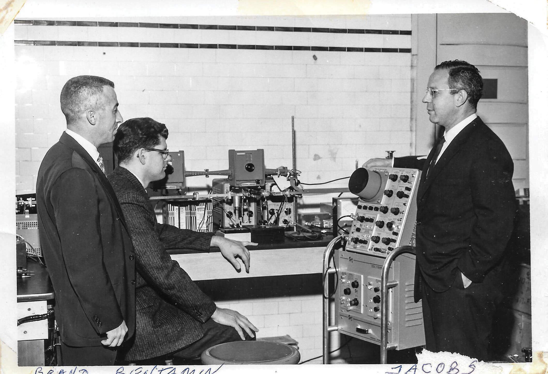 From left, Dr. Frank Brand, Dr. Richard Benjamin, and Dr. Harold Jacobs with an electric measuring device they developed.