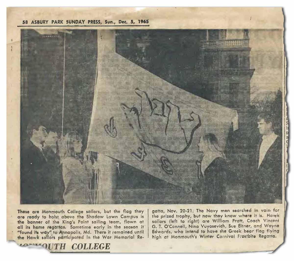 Monmouth College sailors hoisting the U.S. Merchant Marine Academy's Greek bear flag