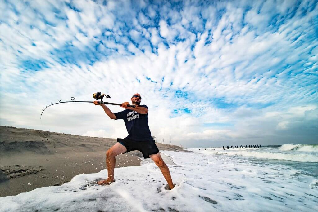 Assistant Professor Keith Dunton casts a line into the Atlantic in hopes of hooking a shark.