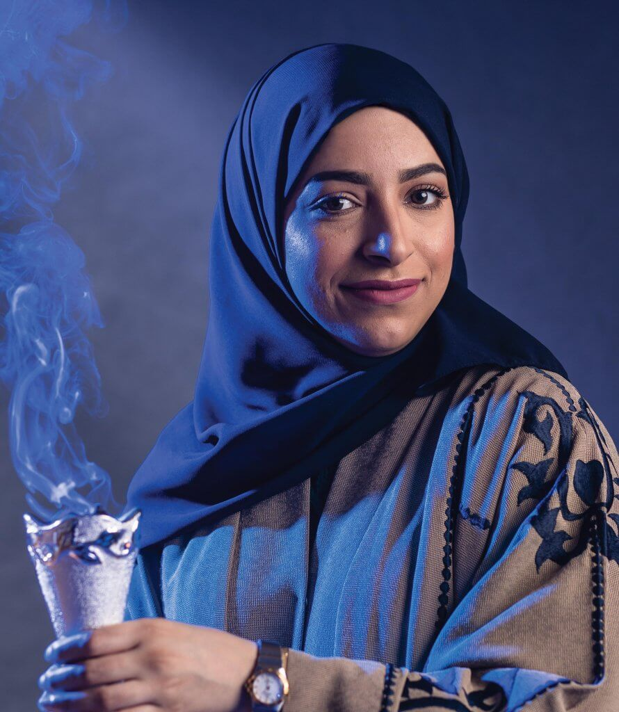 Sarah Almuhaish burning incense in a censer