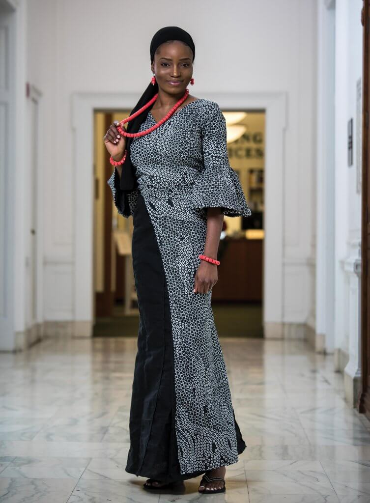 Zainab Audu wearing a dress with different fabrics, each representing her parents' lineages.