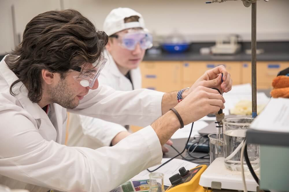 Photo shows Students work on an experiment in the General Chemistry Laboratory in the renovated and expanded Edison Science Building at Monmouth University.