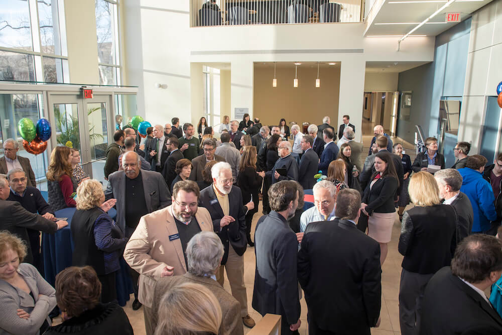 Photo shows guests gathering in the lobby of the new Edison Science Building to celebrate completion of the expansion and renovation of the university's science facilities.