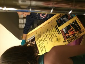 Students review a poster that is part of the Bruce Springsteen student-curated exhibit.