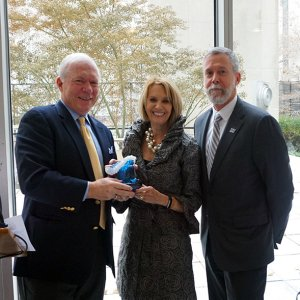 Pictured from left: UCI Director Tony MacDonald (left) and Monmouth University President Grey Dimenna present a Champion of the Ocean Award to National Academy of Sciences President Marcia McNutt.