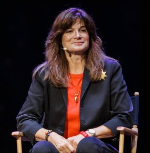 A photo of Carolyn Porco taking at a conference.
