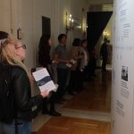 Photo shows audience members viewing the exhibit