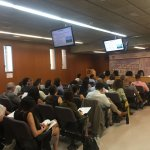 Photo of audience members attending lecture by Dr. Abate in Tarragona