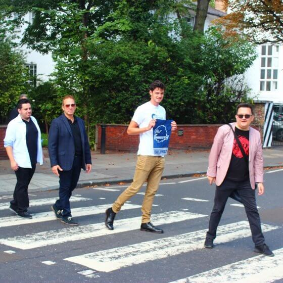 Monmouth students and faculty crossing Abbey Road