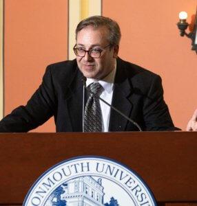 Professor DeRosa speaks at podium