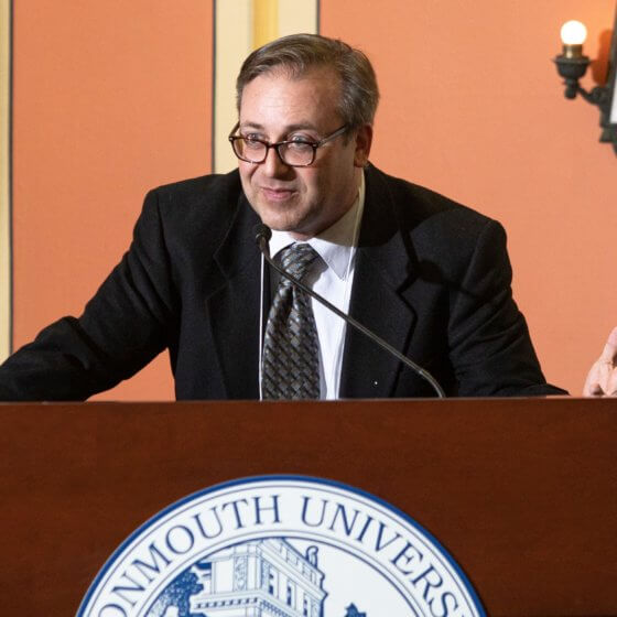 Professor DeRosa speaks at podium