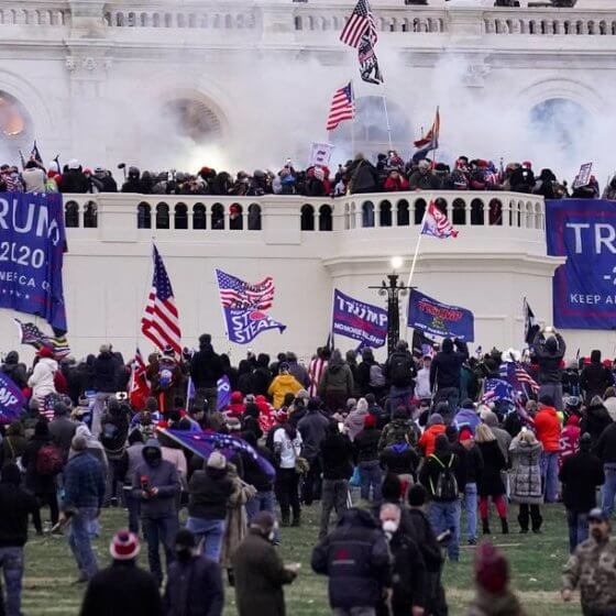 Rioters supporting then-President Donald Trump storm the Capitol on Jan. 6. (John Minchillo/AP)
