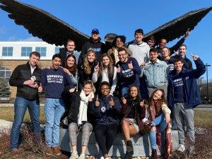 Debate Team around Hawk statue in 2020