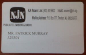 Images Displays Pollster Patrick Murray's Badge from New Jersey Network