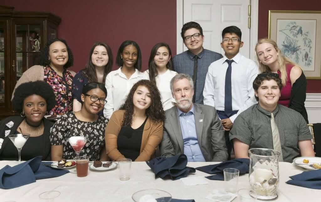 Photo of MU President Grey Dimenna with MU students during dinner at Doherty House