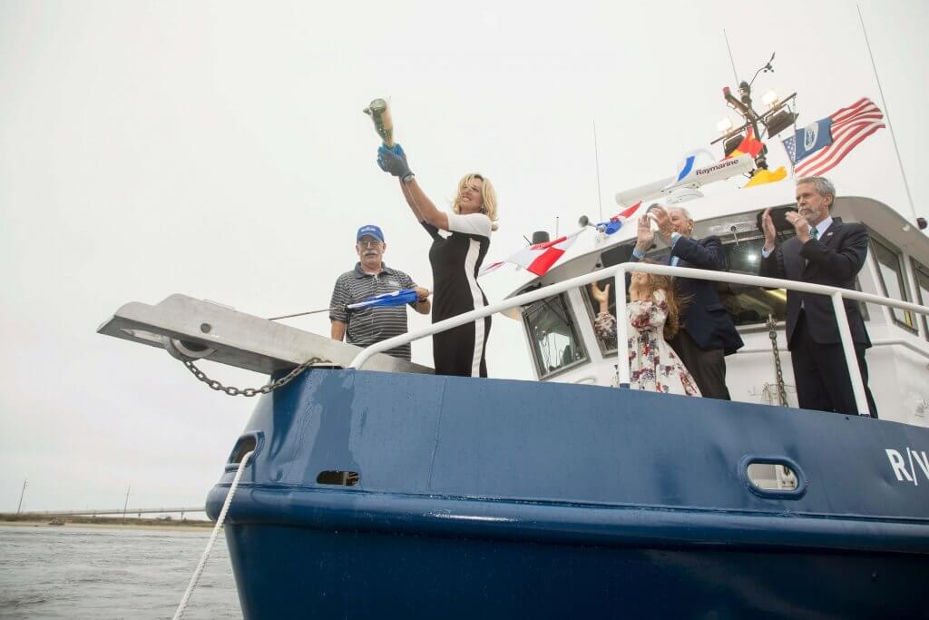Photo of Heather Arincibia christening the R/V Heidi Lynn Sculthorpe in memory of her sister on October 8, 2018.