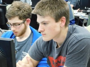 2 male students looking at their computer