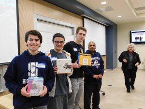 3 male students, sponsor Dr. Lakshmanan and MU Professor Kretsch. Students are holding prizes won for 3rd place in Monmouth University High School Programming contest 2019