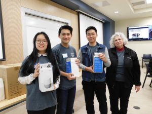 1 female student, 2 male students and MU Professor Kretsch holding Google Home and Chromecast won for 2nd place in Monmouth University High School Programming contest 2019
