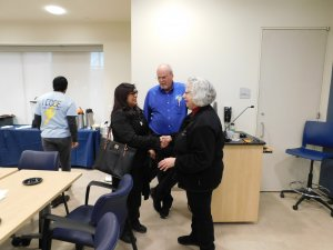 MU Professor Kretsch shaking hands with a female with Middletown High School South teacher Mr. Kretsch in the background