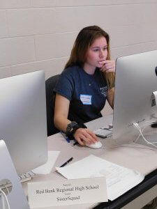 1 female student from Red Bank Regional High School focused and working on her computer