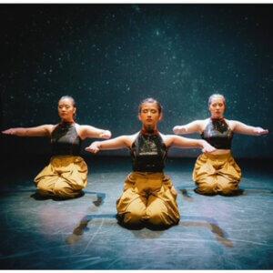 Photo of IMGE Dancers Dancers Ishita Mili, Hanna Gozstyla, and ex Bolisay performing.