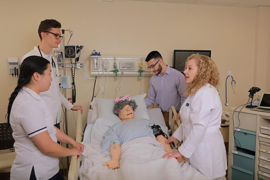 Photo of Instructor and Students during a Nursing Simulation Laboratory session