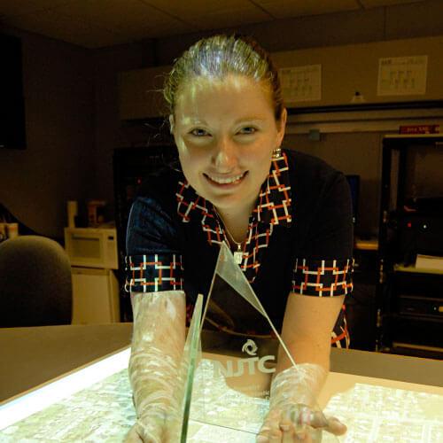 Lauren Landrigan with a New Jersey Technology Council award