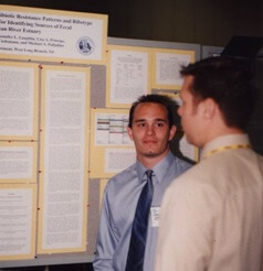 Photo of Lawrence Perruzza presenting his research at the American Society for Microbiology, 2001.