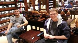 Photo shows Patrick with his School of Science protege (now Peer Mentor) Harris Kittner, at Brooks Brothers waiting for a fitting before the Communicate Your Professionalism event in 2012.