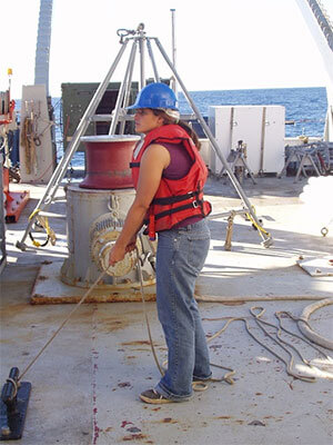 Photo of Sindia Sosdian collecting a sediment core on research cruise during her Ph.D. studies.