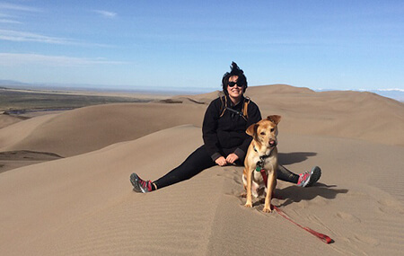 Photo of Emily Pumphrey Pearson with dog Murray in Sand Dunes National Park
