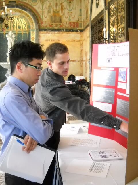 Photo of Justin Hanenberg presenting his research to Dr. Pang at the Student Research Conference 2010