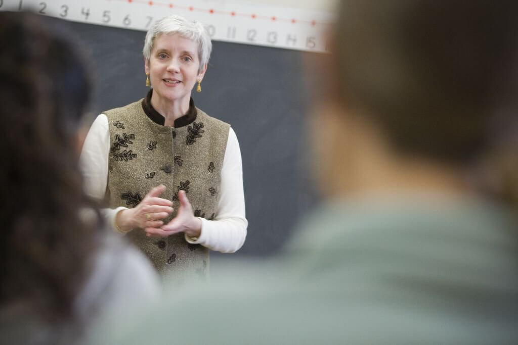 Photo shows Dean of Social Work Robin Mama teaching a class in graduate social work.
