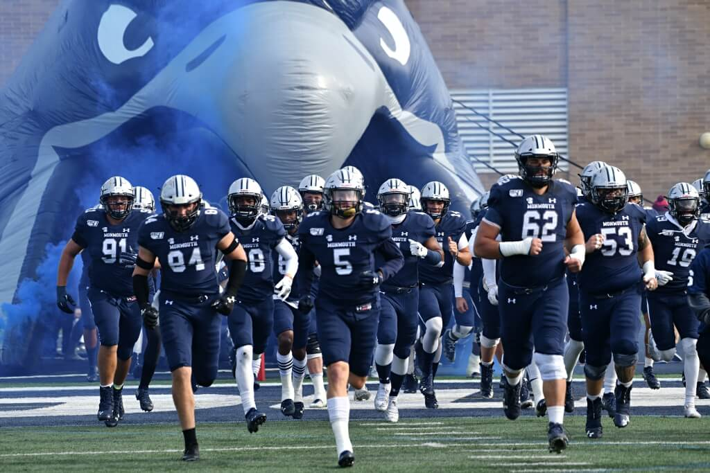 Photo of Monmouth Hawks Football Team taking the field