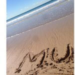 Photo of MU written on Australian beach 2017 - Click to view larger image