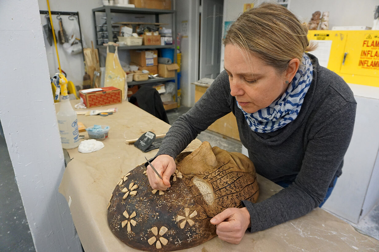 Assistant Professor of Art and Design Kimberly Callas working on her nature-inspired Discovering the Ecological Self project