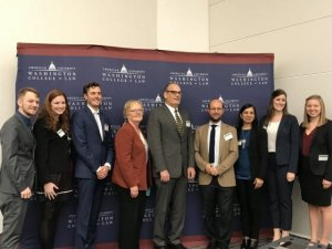"""Photo of Dr. Randall Abate and panel members who addressed climate change displacement and migration at a symposium titled """"The Legal Effects of Environmental Destruction on Human Rights and Global Migration"""" held at American University Washington College of Law"""