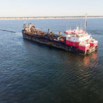 Photo of large cargo ship on water