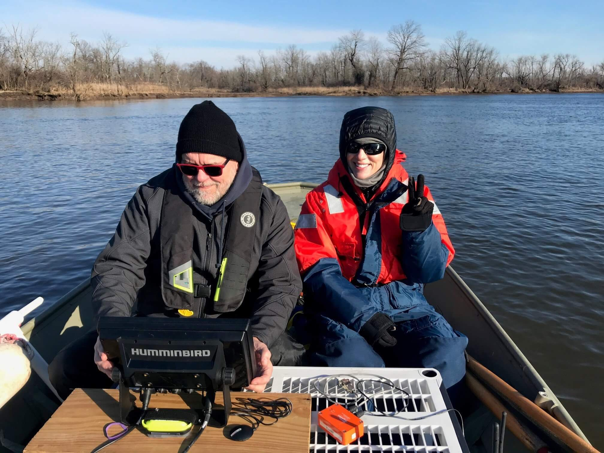 Photo of MU graduate student Jaclyn Urmey (right) and Stockton University Adjunct Professor Steve Nagiewicz scanning Crosswicks Creek in February.