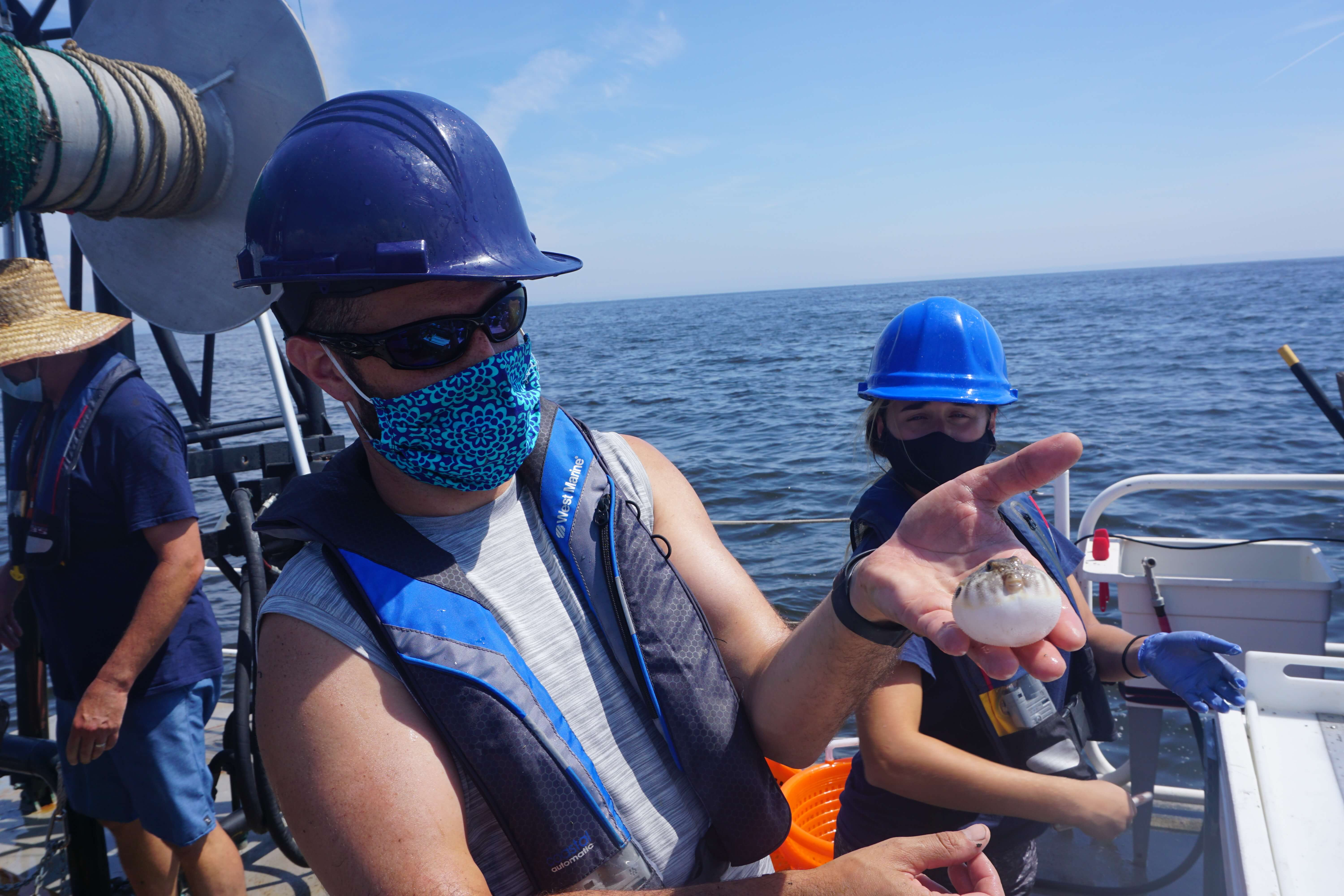 Photo of research team in boat on the water