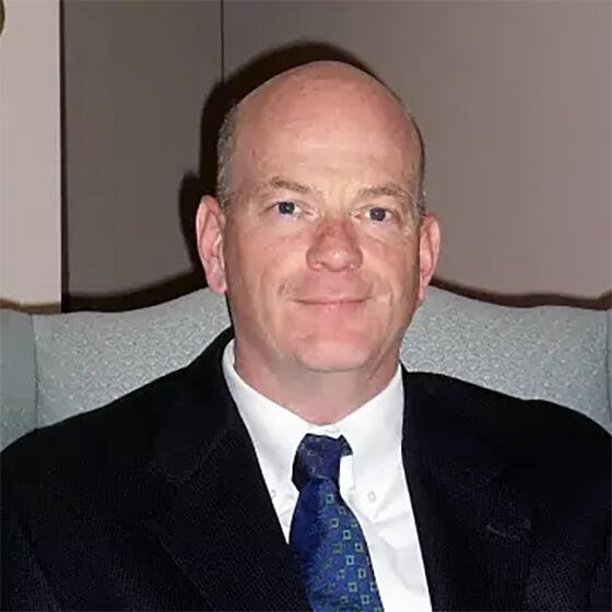 Photo of John Comiskey