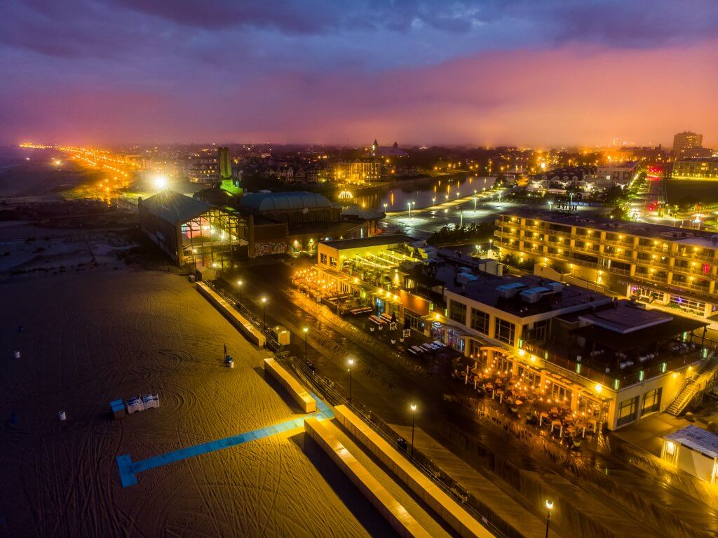 Photo shows nighttime aerial view of Asbury Park, NJ