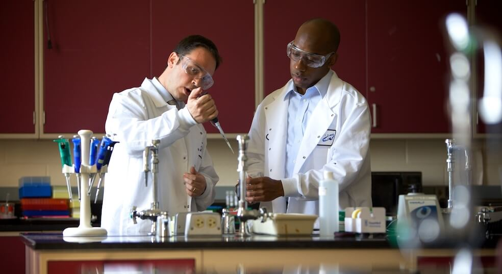Assistant Professor of Chemistry, Massimiliano Lamberto Ph.D. giving a lesson in Spring 2010 to Kwesi St. Louis, a chemistry major going to Medical School.