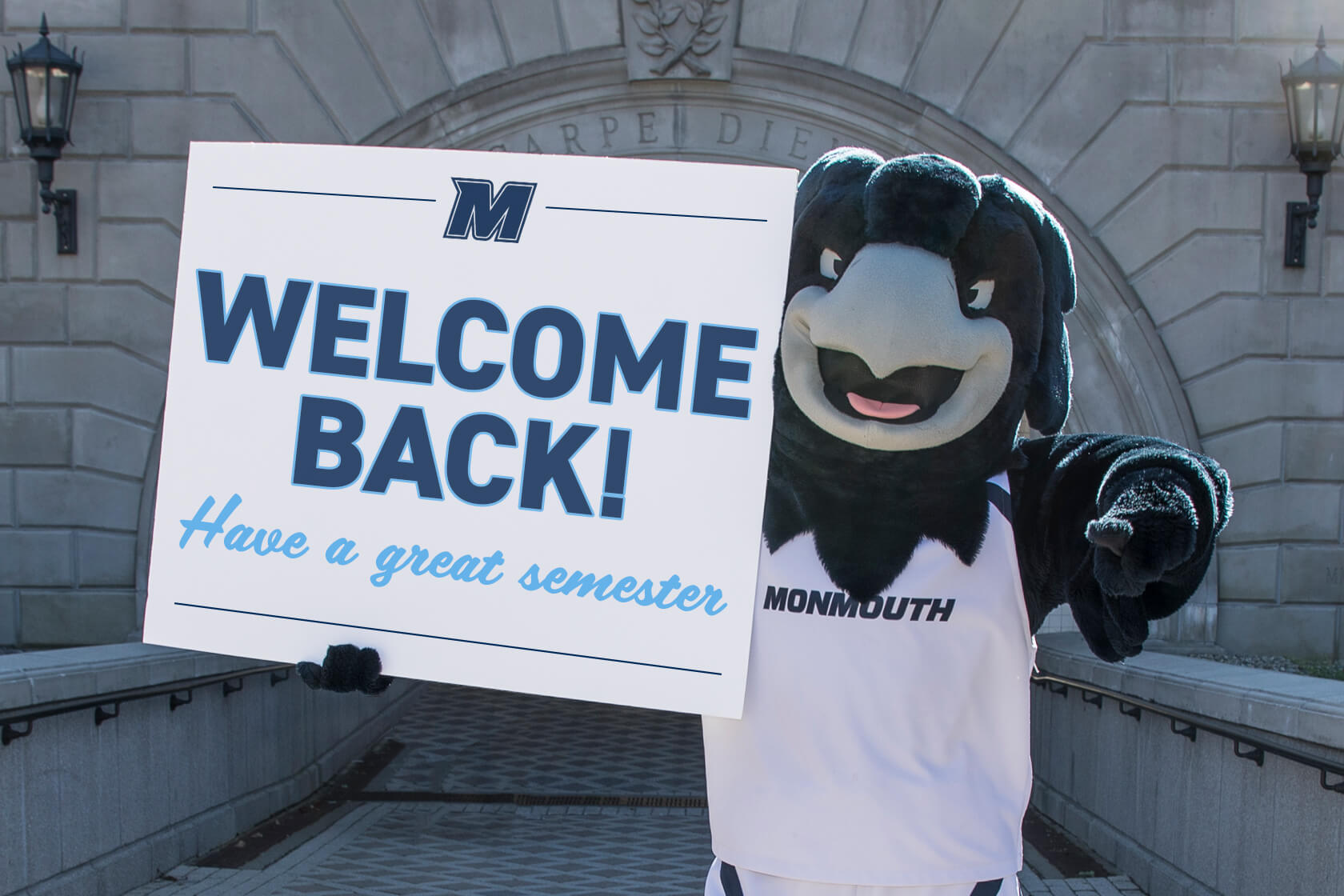 Shadow, our mascot, holding a sign that says Welcome Back, Have a great semester