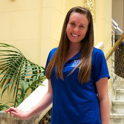 Erin McMullen on the first floor steps of Wilson Hall
